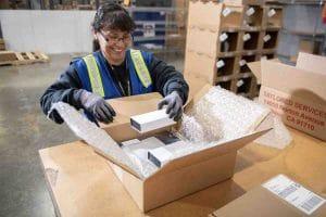 Woman packaging a box